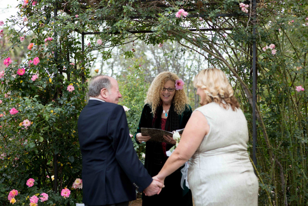 The bride dreamed of getting married under a rose arbor.